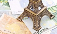 14877549 - eiffel tower model with euro banknotes
